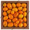 kumquats in a rustic, wooden box