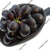 scoop of black grapes