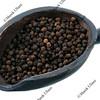 scoop of black peppercorns