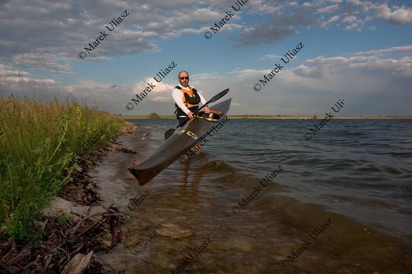 racing kayak launching on a lake