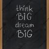 think big, dream big slogan on blackboard
