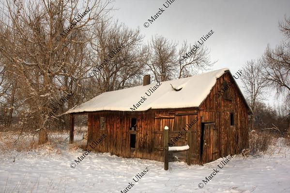 old farm building in winter scenery