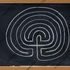 seven ring labyrinth on blackboard