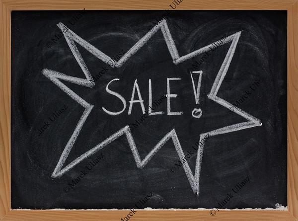 sale sign concept on blackboard