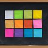 colorful sticky notes on blackboard