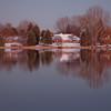 luxury houses on a lake shore at dusk