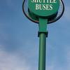 shuttle buses sign against blue sky