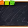blank blackboard with sticky notes