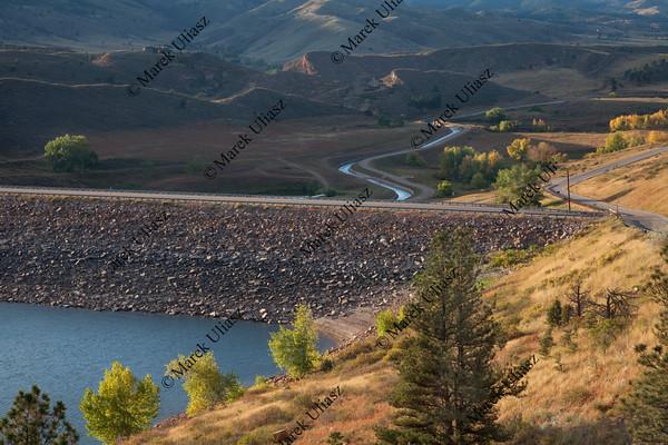 rock dam on mountain reservoir in Colorado
