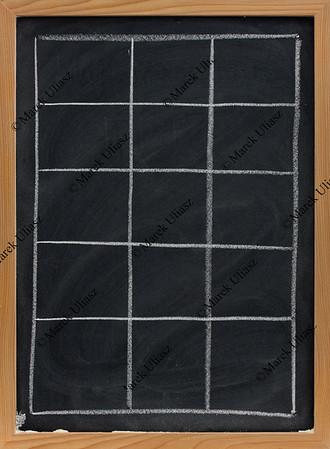 blank table on blackboard in vertical