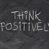 think positively slogan on blackboard
