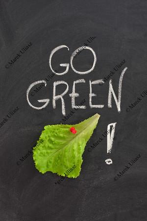 go green concept on blackboard