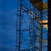 construction scaffolding against nighttime sky