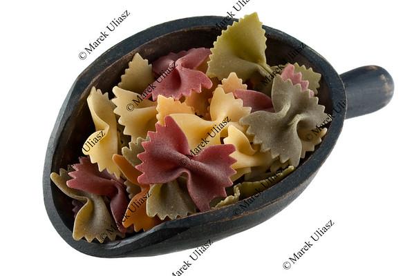 scoop of vegetable bowties pasta