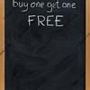 discount sale advertisement on blackboard in vertical