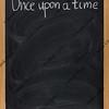 storytelling opening phrase on blackboard