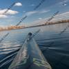 bow of racing kayak number thirteen on lake
