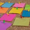 colorful blank sticky notes on cork board