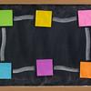 blank blackboard with sticky notes frame