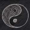 yin and yang symbol on a blackboard