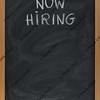 now hiring text on blackboard