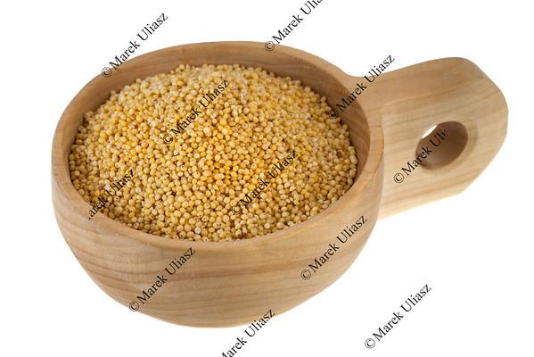 scoop of hulled millet grain