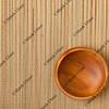 empty wooden bowl on mat