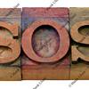 sos sign in letterpress type
