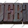 debt word in letterpress type