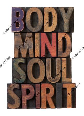 body, mind, soul, spirit in old wood type