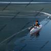 canoe paddling on ice covered lake