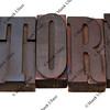 story - word in letterpress type