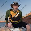 paddler boarding his canoe