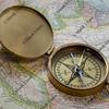 brass compas over South America map