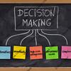 decision making concept on blackboard