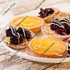 fruit mini tarts and coffee