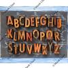 letterpress alphabet on blackboard