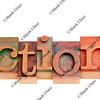 action word in letterpress type