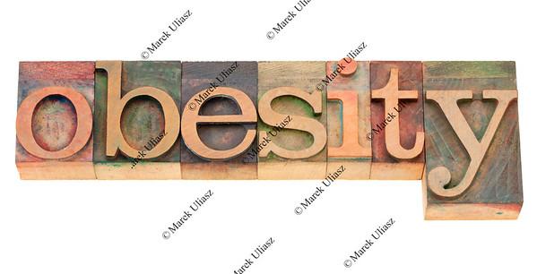 obesity word in letterpress type
