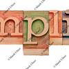 simplify - word in letterpress type