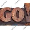 go - word in letterpress type