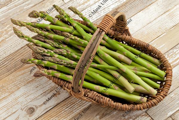 green asparagus in wicker basket