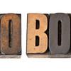 pro bono word in wood type