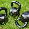 heavy kettlebells in grass