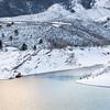 mountain lake at winter dusk
