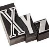 xyz letters in metal type