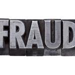 fraud word in metal type