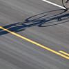 bike, road and shadow