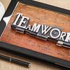 teamwork  word in metal type