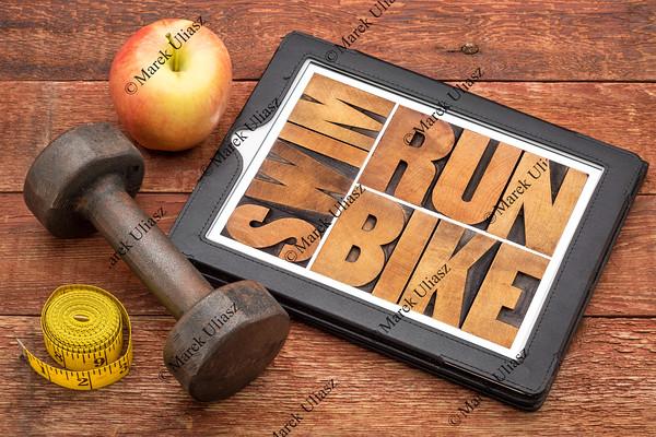 run, bike, swim - fitness concept